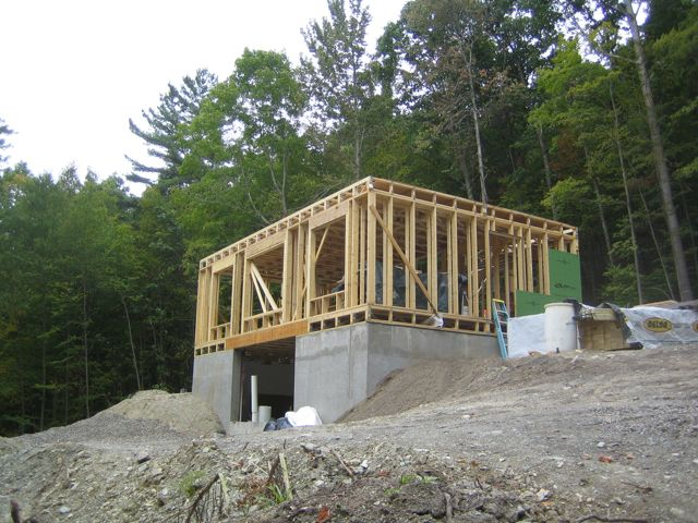 More framing up hill house for Exterior stud wall construction