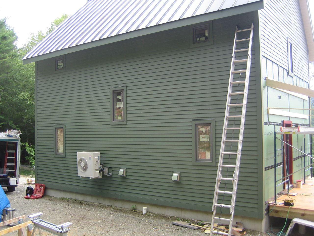 Building an open shed roof dog house over it is better than nothing  #4E577D