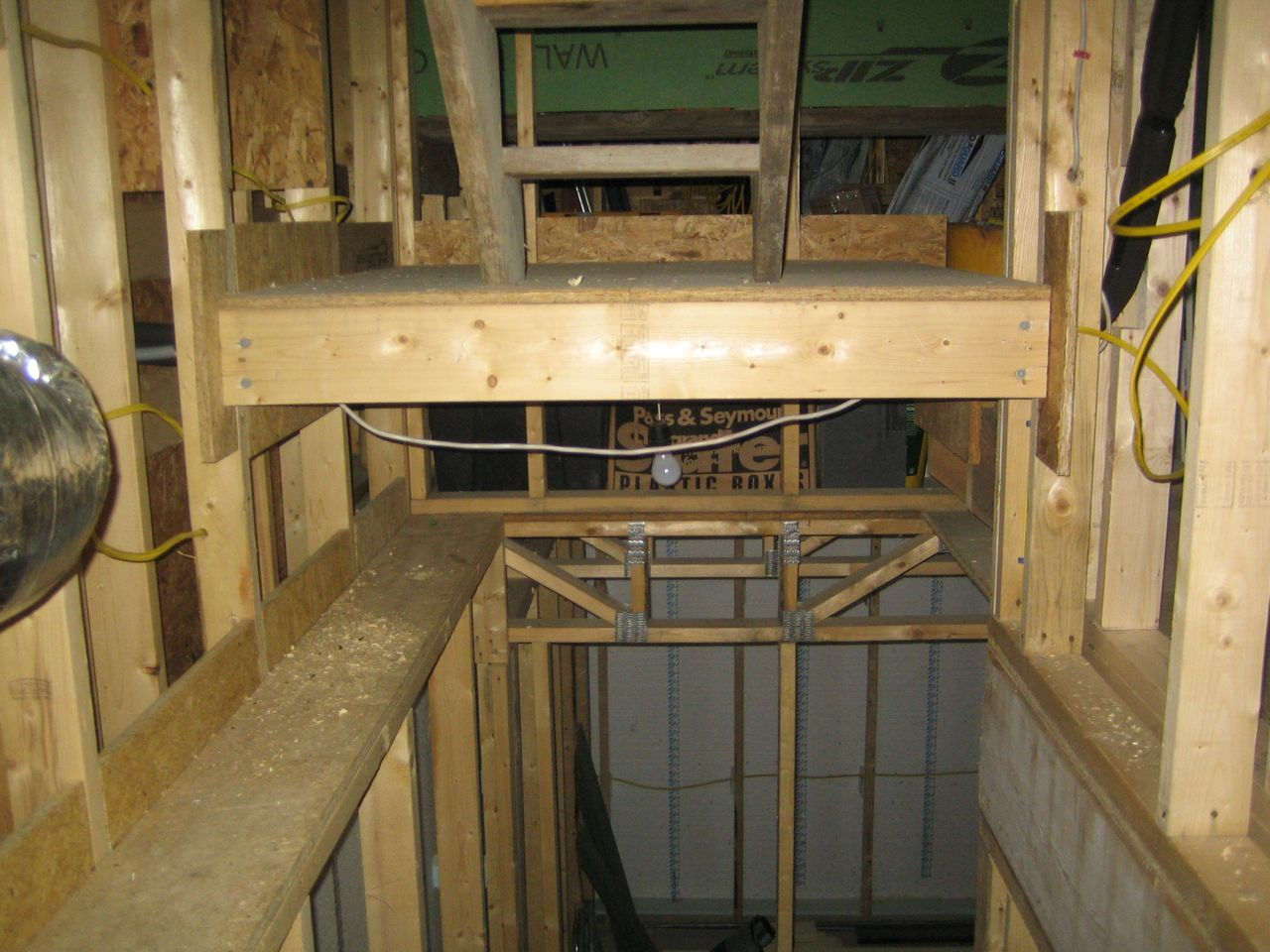 view of landing from basement stair tubing enters landing on right